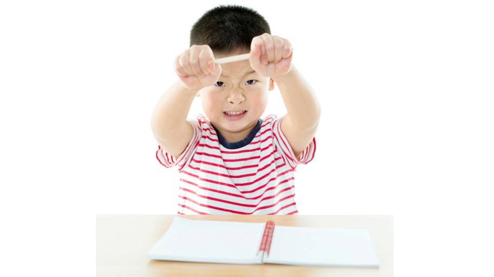 Frustrated kid with homework