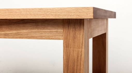 5) Don't sit at the sharp and pointed edge of a rectangular or square table